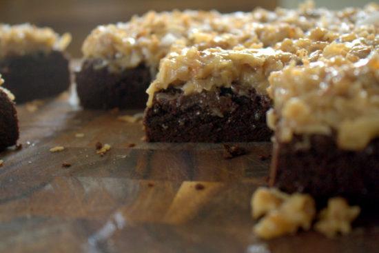 dark chocolate brownies with an ooey gooey coconut pecan icing